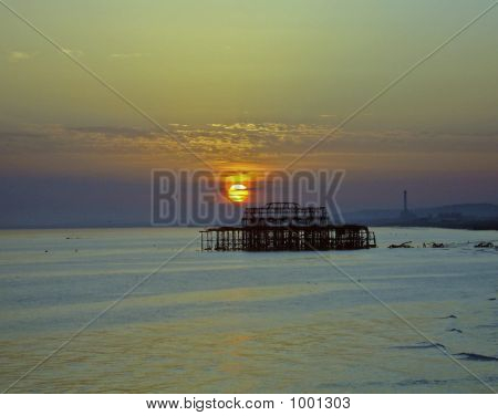 Sunset And Broken Pier