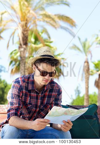 Travel Man Sitting Outside Looking At Map