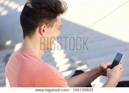 Young Guy Typing Text Message On Cell Phone
