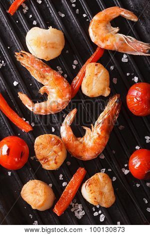Cooking Scallops And Shrimp On Grill Close-up. Vertical Top View