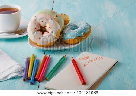Donuts On Table With Sketchbook