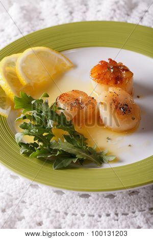 Delicious Grilled Scallops With Sauce And Lemon On A Plate.  Vertical