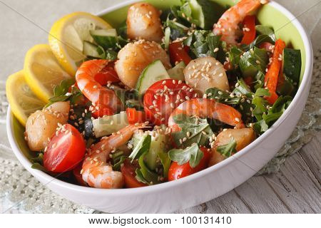 Fresh Salad With Shrimp, Scallops And Vegetables Close Up In A Bowl.