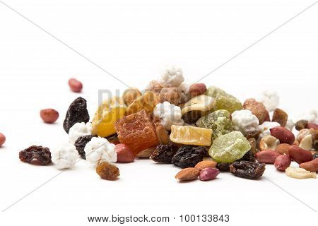 mixed nuts and dried fruit on a white background