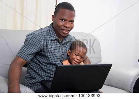 happy family in front of a laptop.