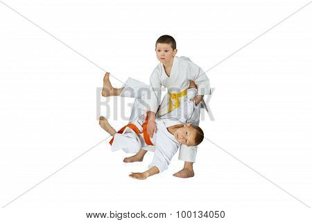 Throw Judo performs athlete with yellow belt