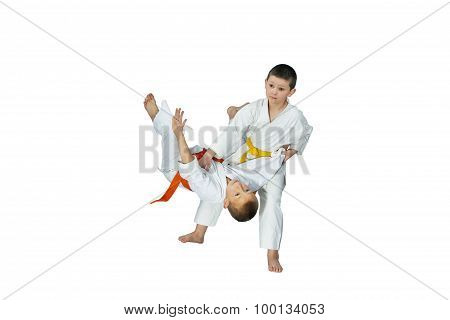 Two athletes perform judo throws