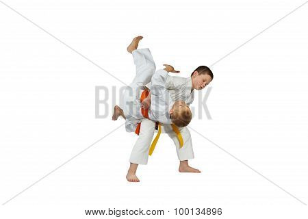Sportsmens in judogi are doing high throws