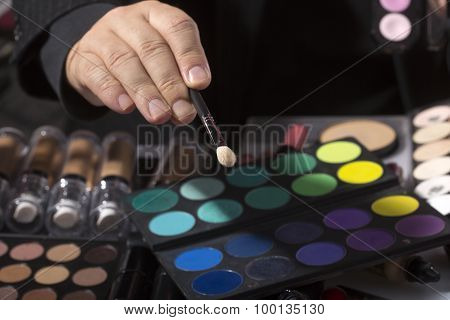 Male Hand And Set Of Eyeshadows