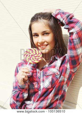 Portrait Of Pretty Young Smiling Girl With Sweet Lollipop In Summer Day