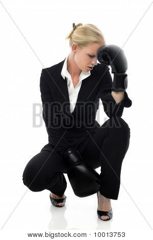 portrait of a young caucasian businesswoman tired with boxing gloves