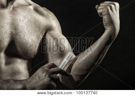 Male Biceps And Syringe
