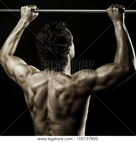 Young Man Doing Chin-ups