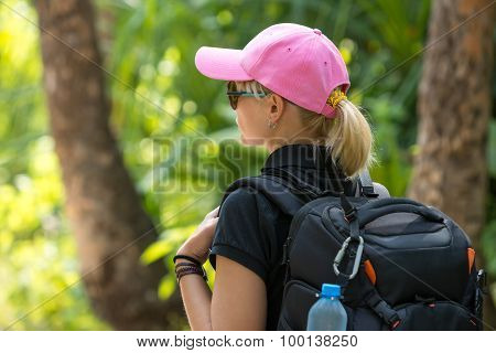 Young Tourist With Backpack Walking In Tropical Jungle