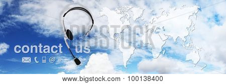 contact concept headset with map on sky and contact us text