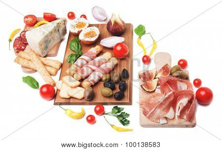 Prosciutto di Parma and other italian food isolated on white background