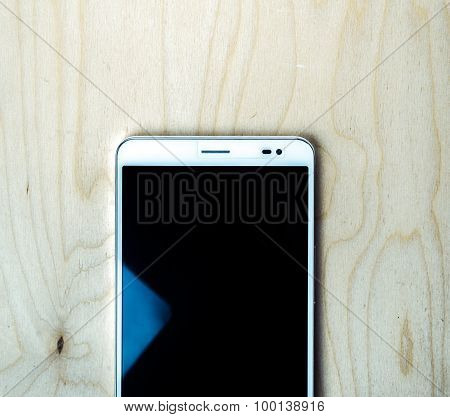 Tablet PC on wooden background