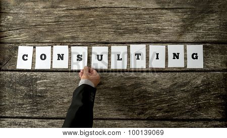 Business Consultant Assembling The Word Consulting