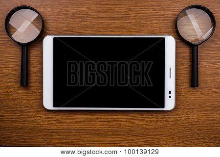 Gadget on wooden desk