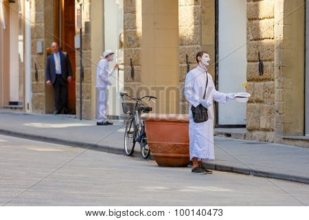 White clowns on the street in Florence, Italy