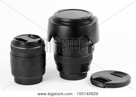 Wide angle lens for digital photo cameras and macro lens on white background