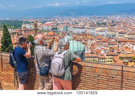 Tourists making photo in Florence, Italy