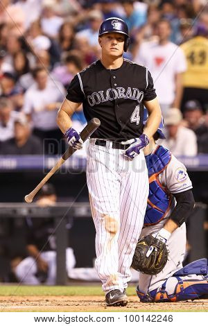 DENVER-AUG 21: Colorado Rockies catcher Nick Hundley waits for a pitch during a game against the New York Mets at Coors Field on August 21, 2015 in Denver, Colorado.