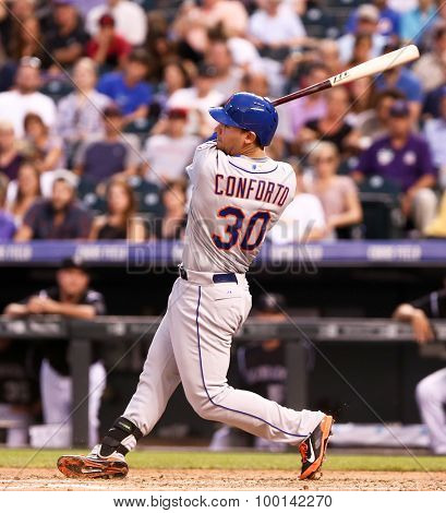 DENVER-AUG 21: New York Mets outfielder Michael Conforto swings at a pitch during a game against the Colorado Rockies at Coors Field on August 21, 2015 in Denver, Colorado.