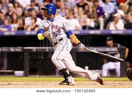 DENVER-AUG 21: New York Mets outfielder Yoenis Cespedes swings at a pitch during a game against the Colorado Rockies at Coors Field on August 21, 2015 in Denver, Colorado.