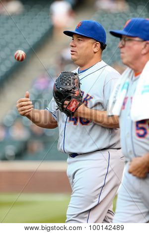 DENVER-AUG 21: New York Mets pitcher Bartolo Colon (L) and pitching coach Dan Warthen walk the field before a game against the Colorado Rockies at Coors Field on August 21, 2015 in Denver, Colorado.