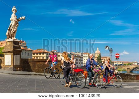 Cyclists on Bridge Santa Trinita, Florence, Italy