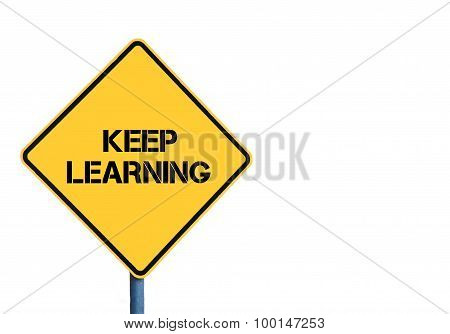 Yellow Roadsign With Keep Learning Message