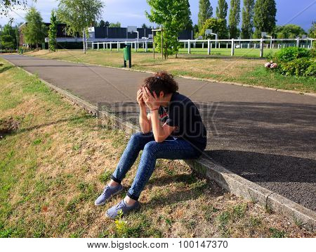 Upset Girl Sitting In The School Yard