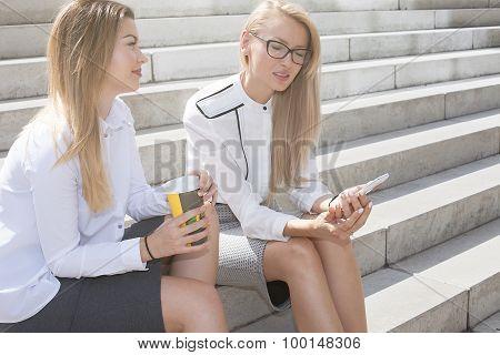 Two Businesswoman Talking.