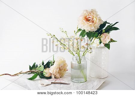Florist Preparation Of A Selection Of Vases Scissors And String Horizontal