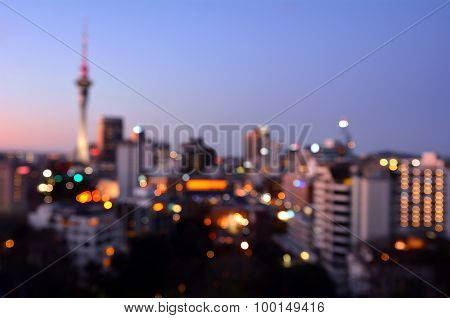 Bokeh Background Of Auckland Financial Center Skyline At Dusk