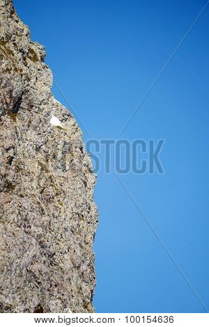 steep rock and blue sky