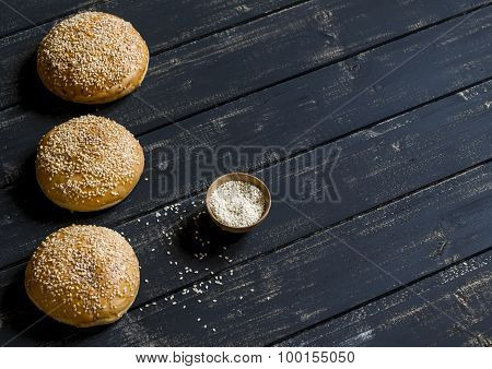 Homemade Buns For Hamburgers On Dark Wooden Surface