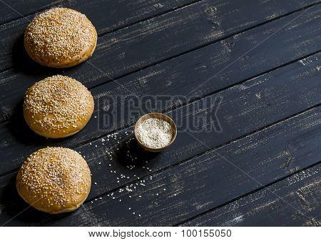 Homemade Buns For Hamburgers On Dark Wooden Surface