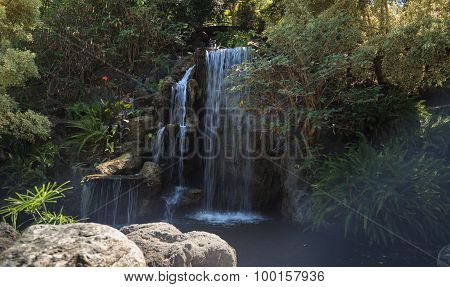 Deep tropical forest waterfall in Hawaii in Spring