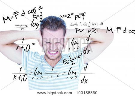 Handsome casual man screaming with hand on ears against maths equation