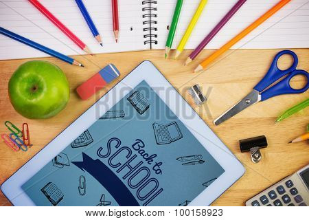 Back to school message with icons against students table with school supplies