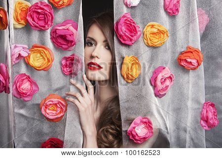 Beauty fashion model girl portrait with flowers. Beautiful luxury evening makeup and hair