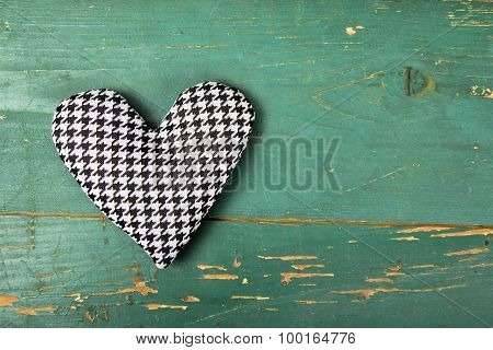 houndstooth heart on a green background