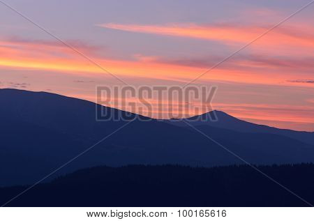 Morning landscape in the mountains. Silhouette peaks at dawn. Beautiful sky. Carpathians, Ukraine, Europe