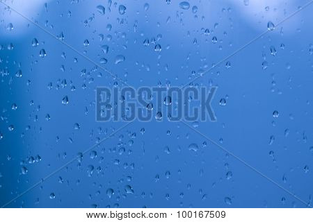 Water drops against blue sky