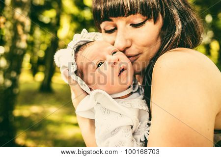 Mother And Her Newborn Baby Outdoor In The Park