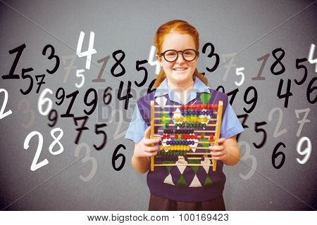 Pupil with abacus against grey background