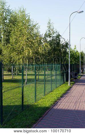 Sidewalk Along The Park