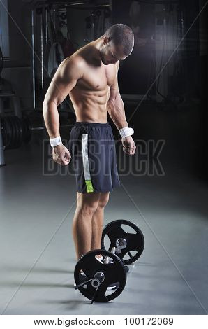 Handsome Muscular Male Model With Perfect Body Posing Next To Barbell
